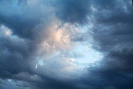 dark evening cumulus clouds in the setting sun 写真素材 - 132392849