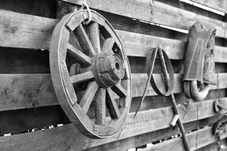 black and white photograph of an old wheel from a village cart 写真素材