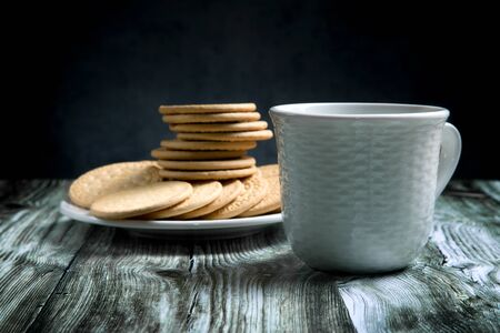 shortbread and a cup of tea on a rustic table 写真素材