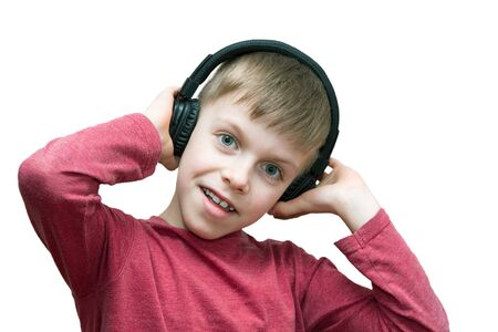 seven year old boy with headphones singing on white background 写真素材 - 132392856