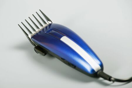 blue hair clipper on a gray background