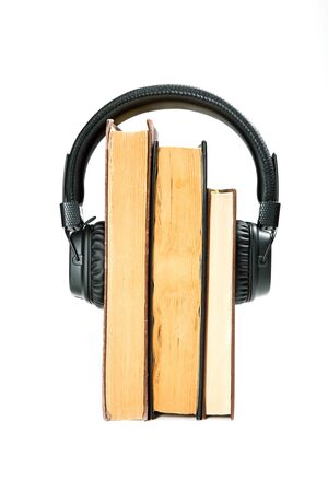 modern headphones on an old book. White background