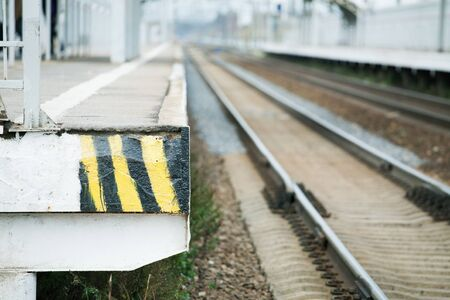 passenger platform and railway line with shallow depth of field
