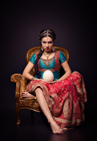 A beautiful Indian princess in national dress and egg photo