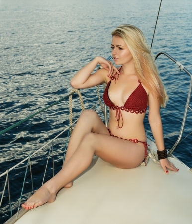 boat, ship, sea, yacht, trip, summer, swimsuit, sail, ocean, young, girl, relax, sunbathing,  relaxation, cruise, warm, leisure, nautical, sexy, white, travel, calm, european,  seasonal, sunny, horizon, caucasian, female, sunshine, tan, recreation, rest,  photo