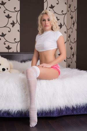 Fashion portrait of young blonde girl in lingerie Stockfoto