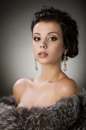 fur coat: Portrait of a young girl in a fur coat Stock Photo