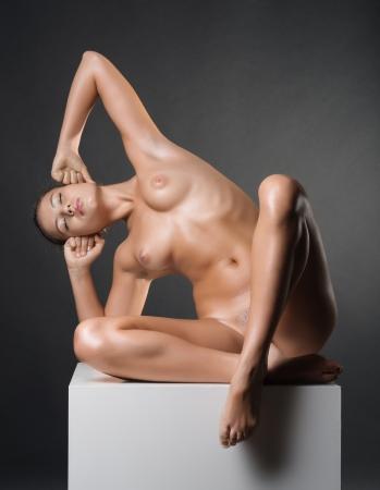 Photo of nude beautiful woman in studio Stock Photo