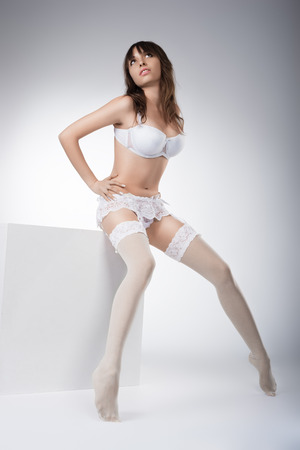 Photo of  beautiful girl in lingerie posing in studio photo