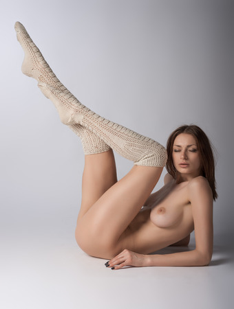 Nude girl posing in studio