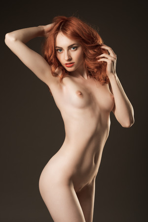 nude breast:   Nude girl posing in studio Stock Photo