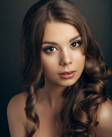 female sexuality: Portrait of a young beautiful brunette girl with long  hair Stock Photo