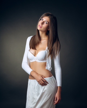 overbearing: Portrait of a brunette posing in a bra Stock Photo