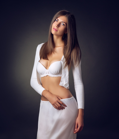 glossiness: The girl in underwear posing in studio Stock Photo