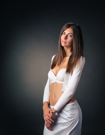 persuasiveness: Portrait of a brunette posing in a bra Stock Photo