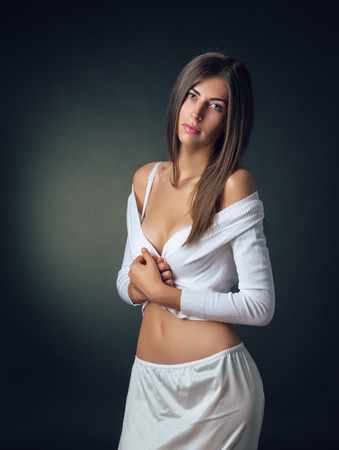 persuasiveness: The girl in underwear posing in studio Stock Photo