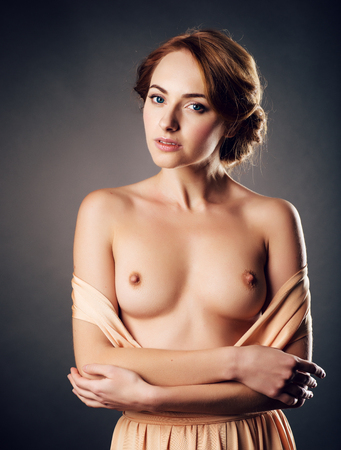 young woman nude: Girl with topless posing in the studio