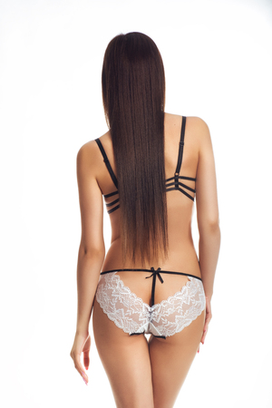 Young slim girl posing in underwear