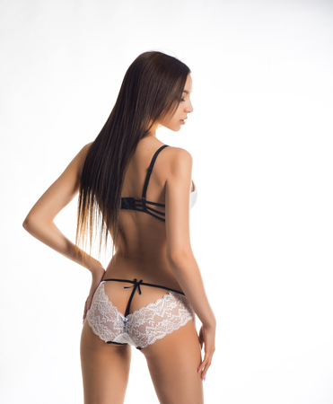 persuasiveness: Girl with long hair in sexy lingerie Stock Photo
