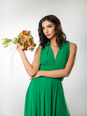 Brunette girl with a bouquet of flowers