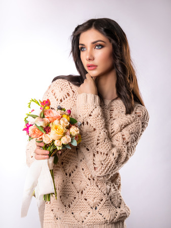 Girl model poses with a bouquet of flowers
