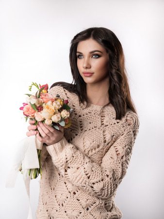 overbearing: Portrait of a beautiful girl with a bouquet of flowers