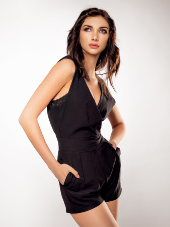persuasiveness: Brunette girl posing in black dress Stock Photo