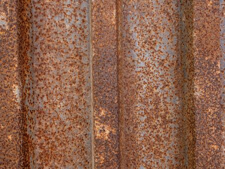 The texture is rusty, old, metal fence. Background