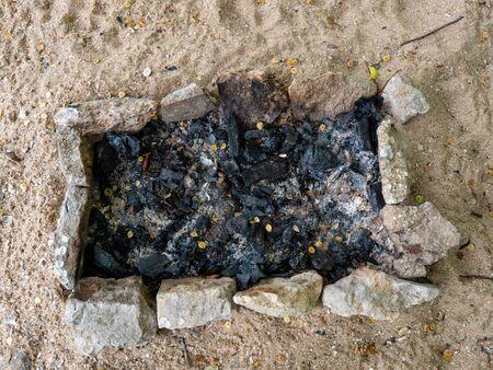 Charcoal texture after a bonfire. Black coals background