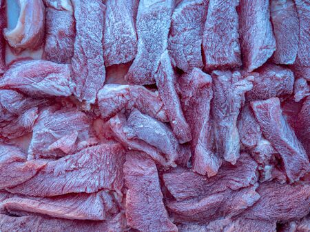 Slices of frozen beef meat thawed on a food tray Reklamní fotografie