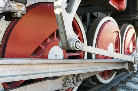 Old steam locomotive. Wheel and rods