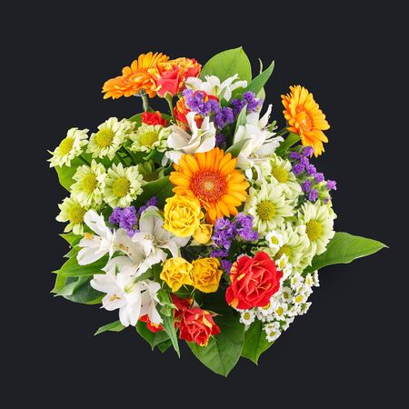 Bouquet of fresh flowers isolated on dark background from above