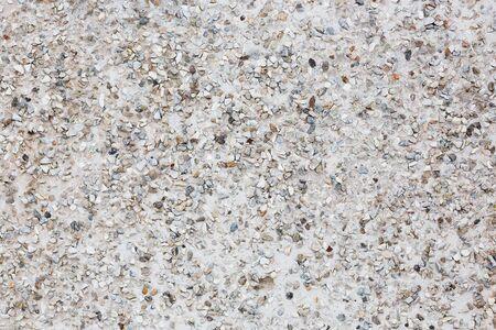 Concrete wall with small pebbles Фото со стока