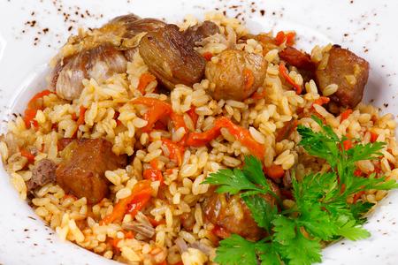 Pilaf with garlic and herbs Фото со стока