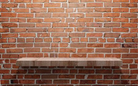 Empty wood shelf on brick wall Фото со стока
