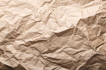 Rough background crumpled kraft paper Фото со стока