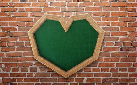 Blackboard shaped as heart on wall