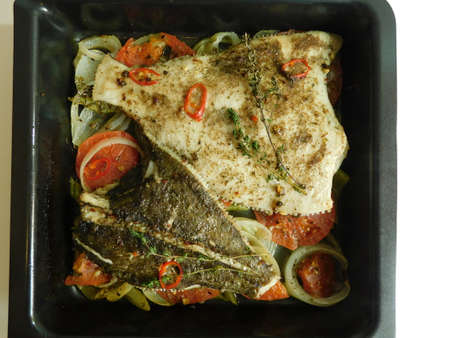 the process of cooking flounder with herbs, onions, tomatoes and white wine