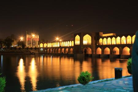 esfahan: sio-se-pol bridge in esfahan, iran, in evening with river flowing