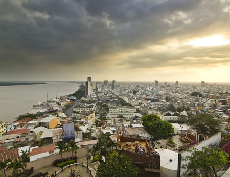guayaquil: view on ecuador city Guayaquil from hill at sunset with clouds on sky