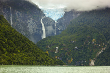 scenic view on glacier ventisquero calgante with waterfall and lake in chilean patagonia on the road Carretera austral Stock fotó