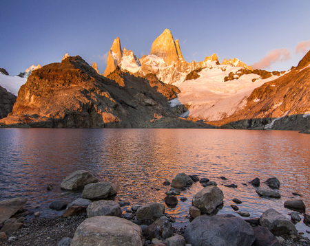Fitz Roy mountain and lake at red sunrise Stock Photo