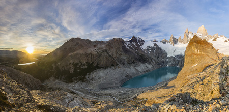 panorama of Fitz Roy mountain and lake at red sunrise Stock Photo
