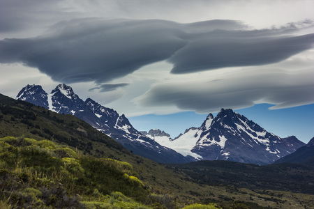lenticular: lenticular clouds above snowy mountains in Patagonia