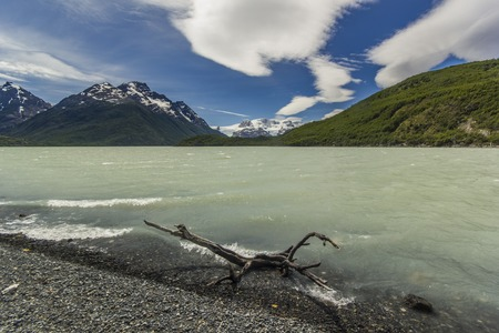 lenticular: shore of dickson lake in patagonia mountains with beautiful lenticular clouds