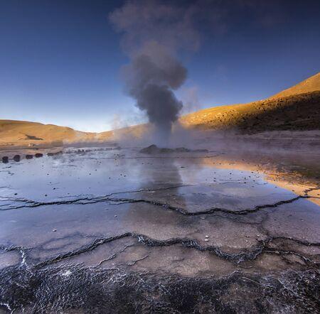 atacama: geyser tatio with water surface at sunrise Stock Photo