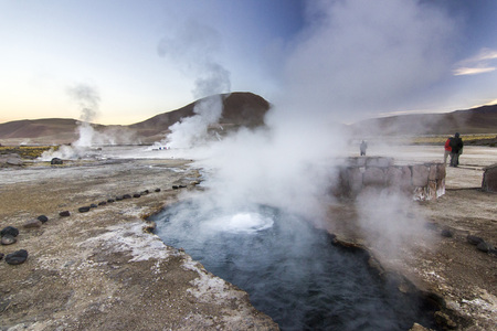 geyser tatio with water surface at sunrise Stock Photo