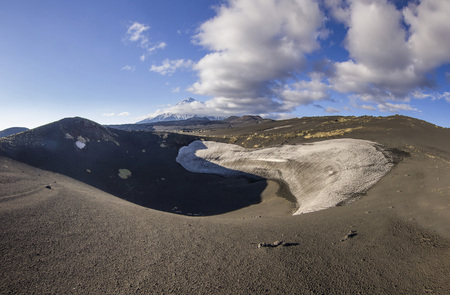 view on Tolbachik volcano from black volcanic sand with few vegetation