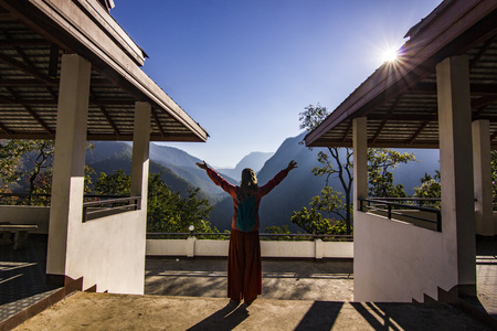 girl standing on viewpoint in north mountains of thailand