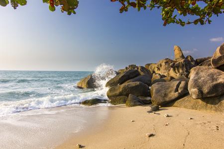 ocean seashore with stone at sunrise in Samui island 写真素材